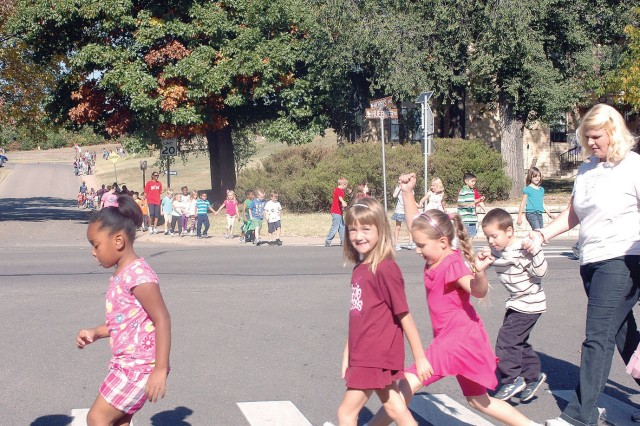 Fort Riley, local students embrace Walk A Mile Day