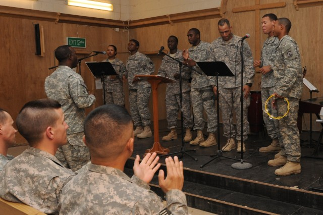 """The Ramadi Gospel Choir of the 2nd Brigade, 82nd Airborne Division ended the Falcon Honor Service with a performance of """"He Is The Light."""" The Falcon Honor Service was held to """"honor the past, celebrate the future"""" by remembering those Service members who made the ultimate sacrifice to bring peace and stability to the Anbar province. The service was held at the Camp Ramadi Memorial Chapel, Iraq, Oct. 9."""
