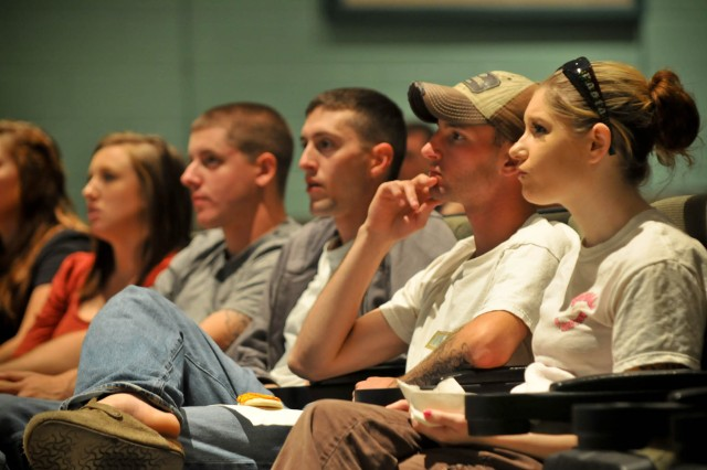 Soldiers and Family Members from 1/30 Inf. participate in a Master Resiliency Training overview and Family Readiness Group meeting held at Fort Stewart's Woodruff Theater, Oct. 5.