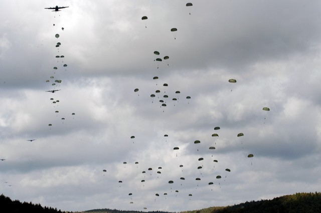 Soldiers from the Polish Land Forces join 'Sky Soldiers' of U.S. Army Europe's 173rd Airborne Brigade Combat Team for a parachute jump into the Hohenfels (Germany) Training Area as part of the brigade's ongoing Full-Spectrum Training Exercise, Oct. 5. More than 100 Polish troops were among the appriximately 650 paratroopers who participated in this morning jump, while another 650 'Sky Soldiers' are scheduled to jump later in the day. (Photo by Richard Bumgardner)