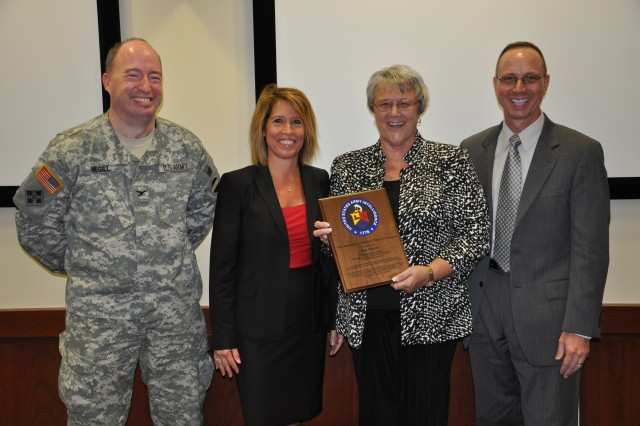 FORT BRAGG, N.C. (Oct. 14, 2011) Kay Buice (second from right), the FORSCOM Command Foreign Disclosure Officer, holds the 2010 Kenneth C. Raymer Memorial Award that was presented to her by Patricia Stokes, senior security advisor to the director of Counterintelligence, Human Intelligence, Disclosure and Security at the Department of the Army. They are joined by Col. Todd A. Megill, the FORSCOM deputy chief of staff G-2, and Scott Schultz, the Department of the Army Foreign Disclosure chief.