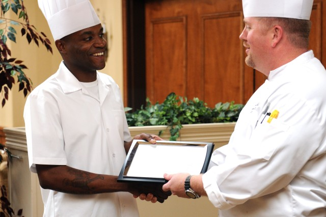"""FAYETTEVILLE, N.C. """"  Pfc. O'Brian Palmer, a food service specialist with 3rd Brigade Combat Team, 82nd Airborne Division receives a plaque from Highland Country Club executive chef Russell Neff following a two-week internship he earned by placing first in the XVIII Airborne Corps and Fort Bragg 2011 best chef competition.  By placing first in the competition Palmer also won a tandem skydive opportunity with the world famous Golden Knights Army Parachute Team. Photo by Sgt. Christopher Harper, 3BCT, PAO (Released)"""