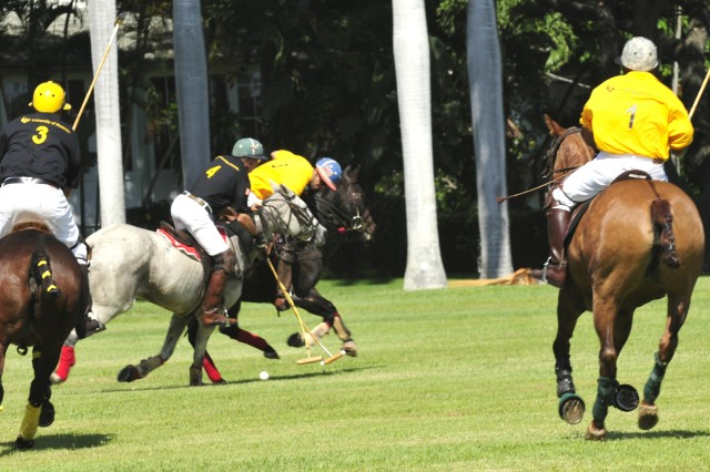Riders with the Army Black and Gold polo teams work to score in a polo match Oct. 15 on historic Palm Circle, Fort Shafter, Hawaii.