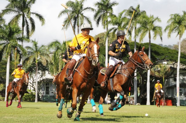 Allen Hoe with Army Gold and Chris Dawson Army Black participate in an exhibition polo match, Oct. 15 at historic Palm Circle on Fort Shafter, Hawaii.