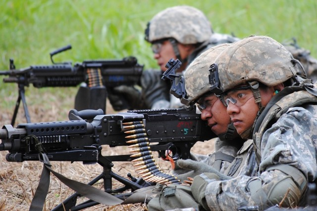 Samoa-based U.S. Army Reservists of Bravo and Charlie Company, 100th Battalion, 442nd Infantry Regiment, 9th Mission Support Command, brush up on their combat skills during weapons qualification. More than 100 Soldiers returned to American Samoa, June 30, 2010, after completing 18 days of training.