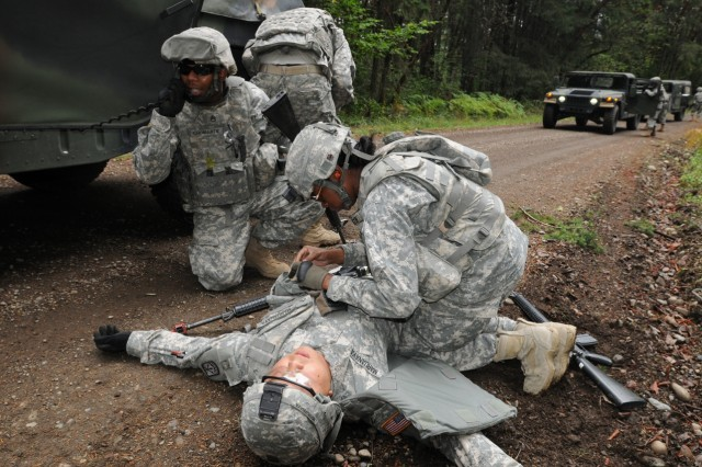 "JOINT BASE LEWIS MCCHORD, Wash. "" Soldiers with the 497th Transportation Company react during a training scenario with casualties and enemy contact during the 593rd Sustainment Brigade's Ultimate Sustainer Competition, Oct. 3-6. (Photo by Sgt. Mark Miranda)."