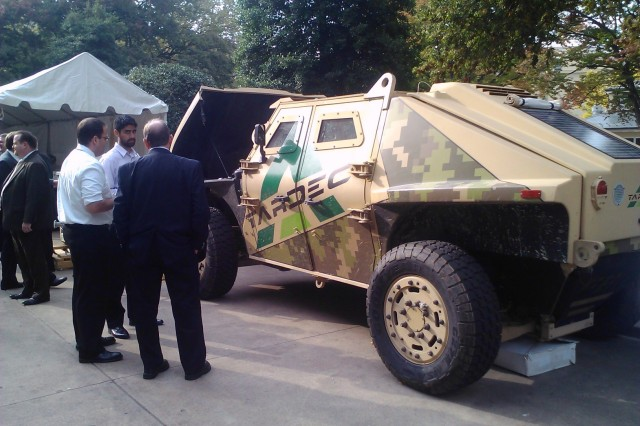 "The Fuel Efficient Ground Vehicle Demonstrator, dubbed ""FED Alpha,"" is displayed Oct. 18, 2011, in the Pentagon courtyard for an Energy & Sustainability Technology Fair. A solar-collection panel can be seen on the rear hatch of the vehicle."