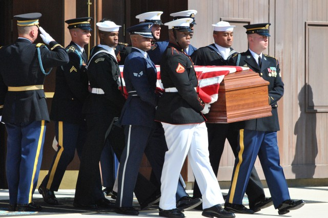 Former Chairman of the Joint Chiefs of Staff Gen. John Shalikashvili's casket is carried to section 30 at Arlington National Cemetery where he was interred Oct. 7. Shalikashvili was the first foreign-born Soldier to become the JCS chairman, rising through the ranks from private to general.