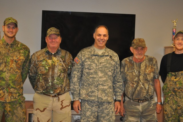 Brig. Gen. Gustave F. Perna, JMC's commanding general, center, greets veterans.  Perna visited Radford Army Ammunition Plant the same day that the wounded warriors were there for a deer bow-hunt.