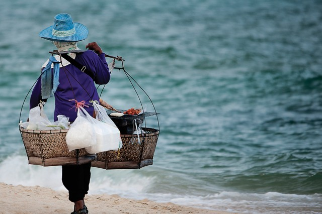 """Army Lt. Col. David Tygart's """"Working on the Beach,"""" taken in Thailand on the island of Ku Samui, won first place in the Active Duty People category."""