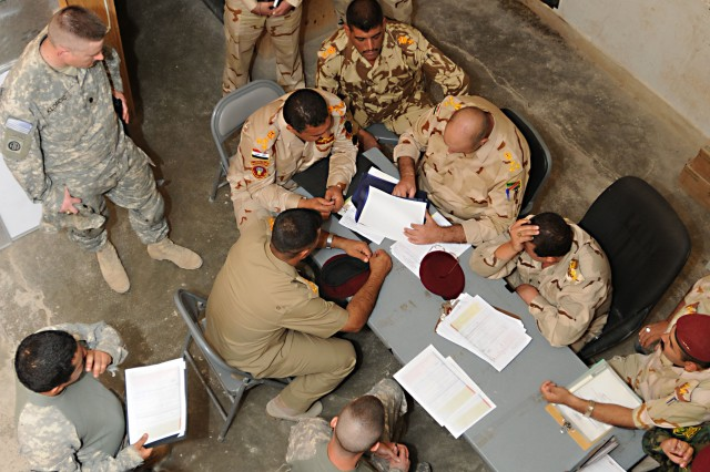 Leaders from the 1st Iraqi Army Division, and the 1st Battalion, 325th Airborne Infantry Regiment, 2nd Brigade, 82nd Airborne Division, discuss the documents that will transition Camp Fallujah from the 1-325th AIR to the Government of Iraq, Oct. 12. Camp Fallujah has an important place in the history of U.S. Military operations in Iraq during Operation Iraqi Freedom, and now Operation New Dawn. What was once a hotbed of extremist violence, murder, and daily bombings, is now a site of relative calm, a radical change over the last eight years. As U.S. Forces withdraw from Iraq the final chapter of Camp Fallujah has been written as the camp is handed over to the Iraqi Army and the Government of Iraq.