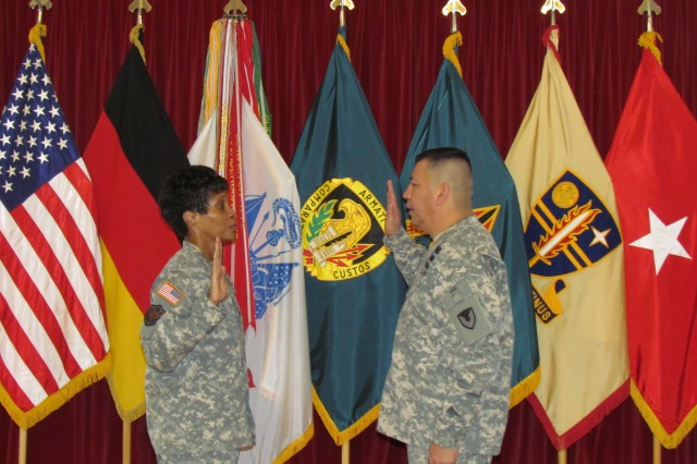 Col. Debra D. Daniels, the commander of the 409th Contracting Support Brigade, swears in Command Sgt. Maj. Bentura Fernandez, the command sergeant major of the 409th Contracting Support Bde., Oct. 6 during his formal appointment ceremony to command sergeant major. Fernandez is the first noncommissioned officer from the acquisition, logistics and technology contracting career field to be appointed as a command sergeant major.