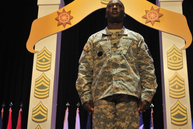 Sergeant 1st Class Ronald Daniels, detachment sergeant, 24th Transportation Battalion, stands center stage at Jacobs Theater after walking through the Noncommissioned Officer's Arch Oct. 13 during the battalion's NCO Induction Ceremony. (U.S. Army photo by Pfc. Alex Kilmon)