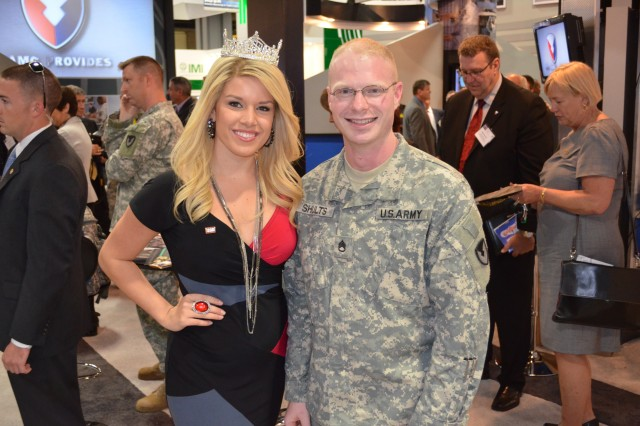 Miss America 2011 Teresa Scanlan and ACC's Staff Sgt. Matthew S. Shults, 903rd Contingency Contracting Battalion, at the AMC booth during the AUSA National Convention.