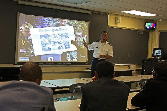 Lt. Col. Fernando Maymi, assistant professor in the U.S. Military Academy's Department of Electrical Engineering and Computer Science, talks to college students about various projects cadets majoring in EECS work on Oct. 15 at West Point during the National Society for Black Engineers Fall Zone Conference. Maymi detailed a project from the computer science department published in the May 11, 2009, edition of the New York Times, where cadets were working on cyber security. Staff members from the National Security Agency helped with the project by hacking into computer systems while cadets attempted to block the invasion.