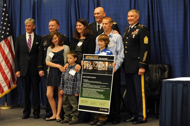 Hon. John McHugh, Secretary of the Army, Army Gen. Raymond T. Odierno, Chief of Staff of the Army, and Sgt. Maj. Raymond F. Chandler III, Sergeant Major of the Army, present the Army Family Covenant with Sgt. Jeremy Barnhart and his family from Fort. Carson, Col., during the Military Family Forum at the 2011 Association of the United States Army Annual Meeting and Exposition in Oct. 10, 2011 in Washington, D.C. Barnhart, his wife Katrina and their children are 2011 Recipients of the AUSA Volunteer Family of the Year Award.