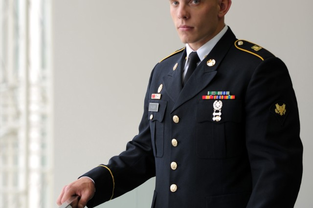 U.S. Army Spc. Thomas Hauser, the Army Soldier of the Year, stands next to the windows at the Washington Convention Center during the Annual Meeting and Exposition of the Association of the United States Army Oct. 11, 2011 in Washington, D.C.  Hauser is representing the U.S. Army Forces Command and the 563rd Military Police Company, 10th Mountain Division.