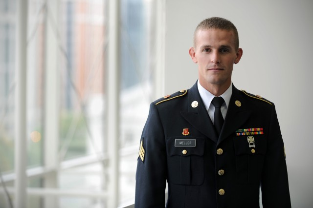 U.S. Army Sgt. Guy Mellor, the Army NCO of the Year, stands next to the windows at the Washington Convention Center during the Annual Meeting and Exposition of the Association of the United States Army Oct. 11, 2011 in Washington, D.C.  Mellor is assigned to the 1st Battalion, 145th Field Artillery, Utah National Guard.