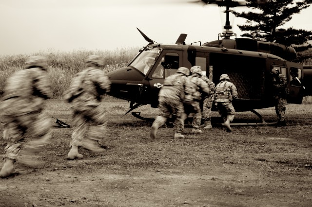 Soldiers with the 3rd Battalion, 141st Infantry Regiment, board a UH-1J helicopter, provided by the Japan Ground Self-Defense Force Eastern Army, 1st Division, 1st Aviation, at the heliborne tactical training during Orient Shield 2011 at Kita-Fuji Training Area, Japan, Oct. 13, 2011.