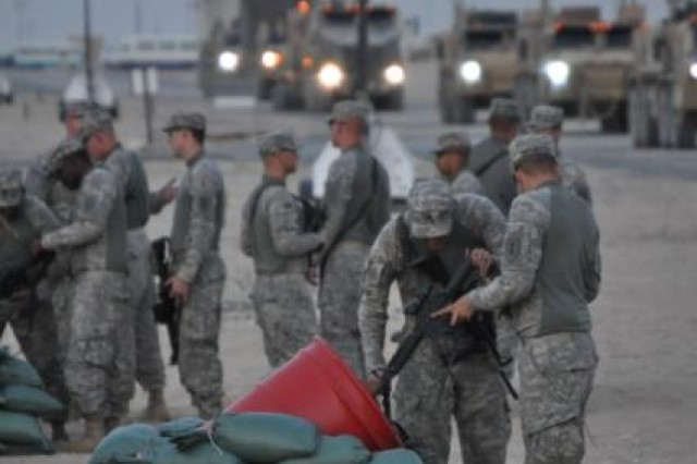 Soldiers clear their individually assigned weapons upon entering the Four Corners operation area in mid-October 2011. The Soldiers are part of self-redeploying units leaving Iraq as part of the responsible drawdown of U.S. Forces from Iraq. The Four Corners operation, headed by the 553rd Combat Sustainment Support Battalion, 230th Sustainment Brigade, is designed to capture all retrograde material from self-redeploying units departing Iraq before the Dec. 31, 2011 deadline in support of Operation New Dawn.
