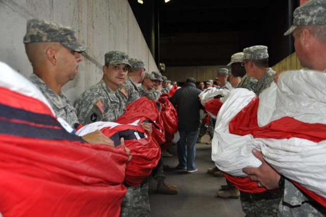 More than 100 Soldiers unfurled the Nations colors at Busch Stadium in St. Louis, Mo., during the opening ceremony for Game 1 of the 2011 World Series Oct. 19, 2011. Major League Baseball dedicated the game between the Texas Rangers and the St. Louis Cardinals to veterans and their families.