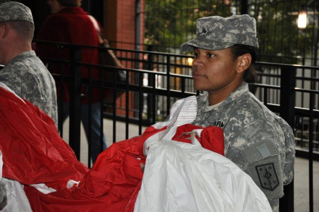 Sgt. Tylomia Dudkiewicz, a human resources specialist assigned to the Headquarters and Headquarters Detachment, 92nd Military Police Battalion holds the Nations colors in preparation of the opening ceremony of Game 1 of the 2011 World Series. Major League Baseball dedicated the game between the Texas Rangers and the St. Louis Cardinals to veterans and their families.