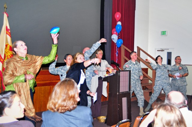 PRESIDIO OF MONTEREY, Calif. - Presidio of Monterey leaders and CFC organizers toss campaign balls toward audience members during the Combined Federal Campaign kick-off ceremony here Oct. 18.