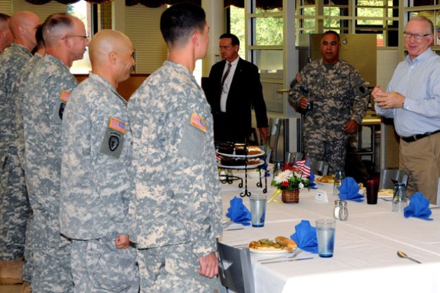 "Rep. Howard P. ""Buck"" McKeon, chairman of the House Armed Services Committee, lunches with Fort Rucker Soldiers Monday during his visit to the post to observe Aviation training and tour facilities."