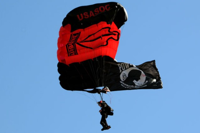 A member of the Black Daggers, the U.S. Army Special Operations Command Parachute team, performs a precision jump during a ceremony commemorating the opening of the 7th Special Forces Group at Eglin Air Force Base, Fla., Oct. 14.