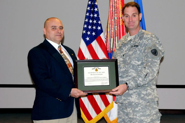 Dan Stamaris, ACLC quality assurance specialist, is presented with the Outstanding Employee with a Disability Award at the headquarters building by Col. Donald N. Galli, USAACE chief of staff.