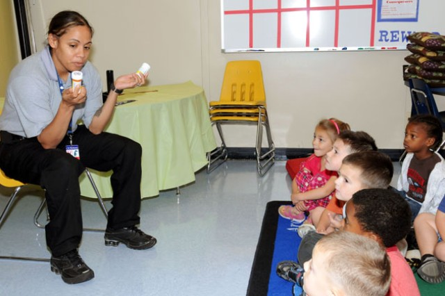 Community Police member Sgt. Zeyna Jimenez instructs Fort Rucker Primary School students on the danger of using drugs during last year's Red Ribbon Week. This year's Red Ribbon Week is Oct. 24-29.