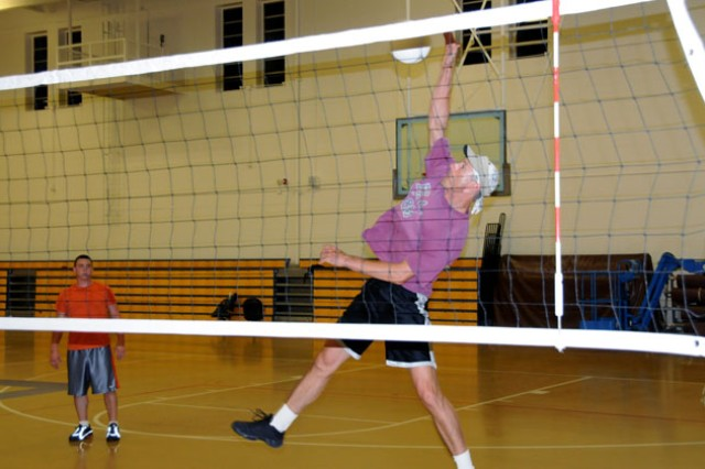 Cody Tucker, 110th Avn. Bde. volleyball coach, delivers a spike to the Lyster team during an intramural volleyball game at the Fort Rucker Physical Fitness Facility Tuesday. The 110th Avn. Bde. won the set, 2-0.
