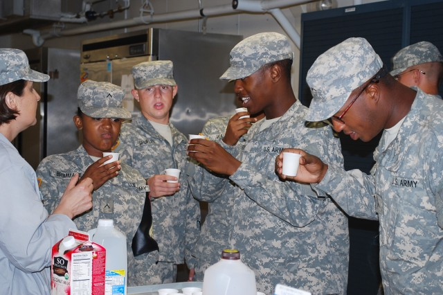 Staff Sgt. Barbara Ortiz instructs Pvts. Shanta Brimmage, Waggoner Spurlen, J'vonte Gunthery and Eustache Mine on performing a sensory evaluation of dairy during the basic Army Veterinary Food Inspection Specialist course.