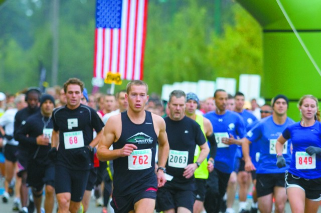 James Roach (762) leads the pack at the start of the Race For A Soldier half Marathon Oct.16. Roach finished second with a time of 1:14.58.