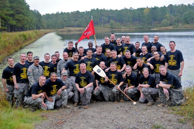 Paratroopers from the 738th Engineer Support Company, 307th Engineer Battalion pose for a group photo after winning first place during the annual Waal River Crossing competition at Kiest Lake on the Fort Bragg, N.C., training grounds Oct. 19, 2011. The Waal River Crossing competition is used to help remember and commemorate those Soldiers who participated in the actual crossing back in World War II.