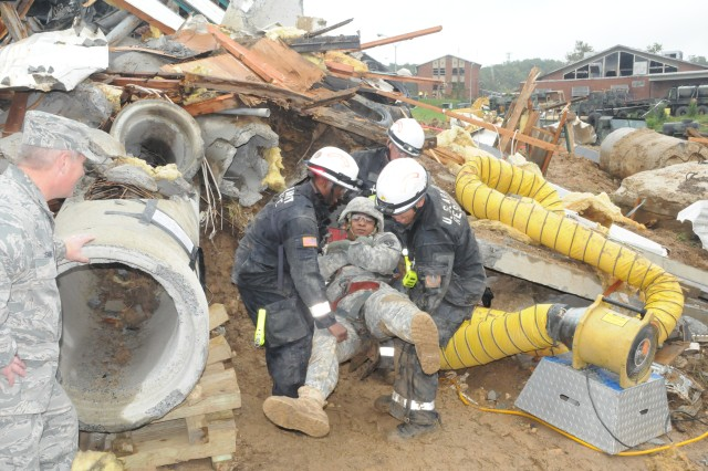 Members of the Army's 911th Technical Rescue Team extract a survivor from a rubble pile during the JFHQ-NCR's Exercise Capital Shield 12, an annual joint training exercise held Oct. 17-20 at Fort McNair in Washington, D.C., and the former Lorton Youth Detention Center in Lorton, Va.