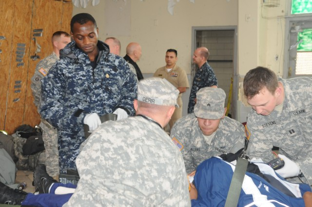 Navy Chief Corpsman Oluyinka Adefisan works as part of a joint service medical response team during the JFHQ-NCR's Exercise Capital Shield 12, an annual joint training exercise held Oct. 17-20 at Fort McNair in Washington, D.C., and the former Lorton Youth Detention Center in Lorton, Va.