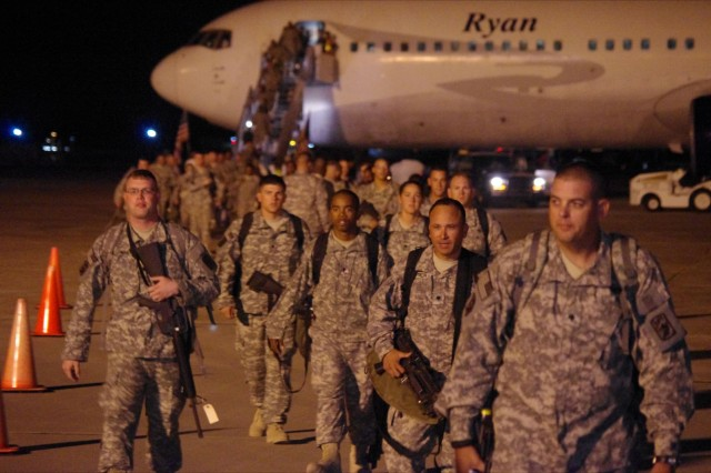 Soldier's of the 416th Trans. Co. deplane at Hunter Army Airfield and anxiously head to the in-processing stations to expedite reuniting with their Families and friends.