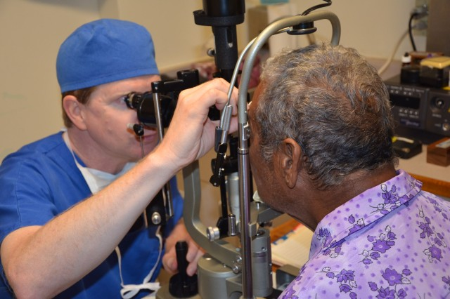Dr. David Gano, an ophthalmologist with Canvasback Ministries Inc., performs a follow up exam Oct. 12, 2011, at Ebeye Hospital in the Marshall Islands, with Bantol Pendinin after cataract surgery, which restored Pendinin's vision. Gano is part of a group of volunteer medical professionals who treated hundreds of patients on Ebeye and Ennibur in the Marshall Islands during October.
