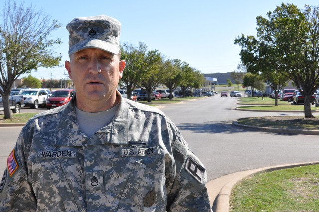 Staff Sgt. Timothy Warden, an infantryman with 1-393 Inf. Regt., 479th FA Bde., stands in front of the III Corps Shoppette Tuesday, where his actions Oct. 9, 2011, helped save a Soldier's life.