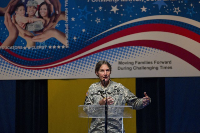 Brig. Gen. Rhonda Cornum, director of the Army's Comprehensive Soldier Fitness program, addresses the Forward March conference in Fayetteville, Oct. 13.