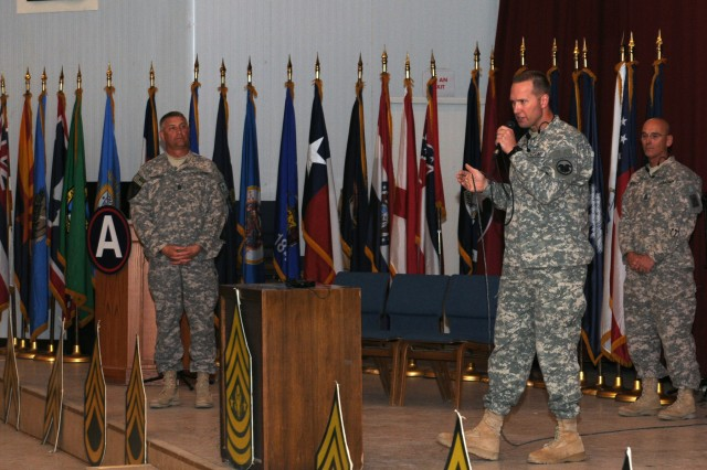 CAMP ARIFJAN, Kuwait - Sgt. Maj. of the Army Raymond F. Chandler III (left), Command Sgt. Major Michael Schultz, Army Reserve Command Sgt. Major (middle), and Command Sgt. Major Richard Burch, Army National Guard Command Sgt. Maj., answer questions during a town hall meeting here with Third Army Soldiers Oct. 21. During the meeting, Sgt. Maj. of the Army Chandler addressed troops on upcoming changes to the Army's retention policy, retirement, Army Combat Uniform, and an overall reduction of forces to take place over the next year. Sgt. Maj. of the Army Chandler's visit furthered Third Army's initiative to shape the future by allowing Soldiers, the strength of our nation, to provide essential feedback and voice their insight on how to improve the Army as a whole for years to come.