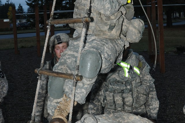 Pvt. Samuel Gable, C Company, 1st Battalion, 17th Infantry Regiment infantryman, prepares to climb a rope ladder as part of the battalion's quarterly fitness test, on Joint Base Lewis-McChord's North Fort, Oct. 6. The timed fitness test uses the Ranger Physical Assessment Test and events introduced by the battalion to test the Soldiers skills as well as mental and physical toughness.
