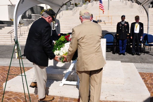 "HONOLULU, Hawaii "" Thomas A. Jones, President of the 25th Infantry Division Association (left) and Gary Dittmer, President Elect of the 25th Infantry Division Association (right) place a wreath at the National Memorial Cemetery of the Pacific during the annual 25th Infantry Division Association Memorial Service on Oct. 2 here. The memorial service was held in honor of all of the Veterans and Soldiers who lost their lives over the past year."