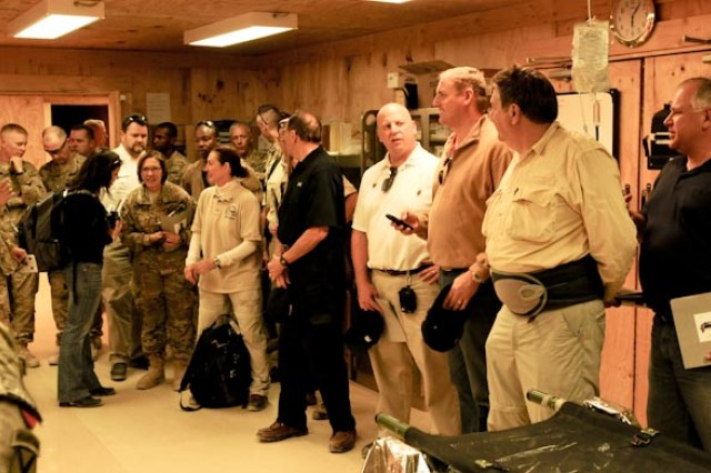 A visiting Congressional Delegation views the trauma bay in the Role II clinic on Forward Operating Base Pasab, Oct. 10.