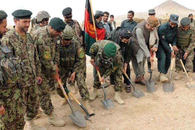 Afghan security force leaders and government officials from Zharay district break ground at the new school and clinic in Kandalay, Oct. 10.