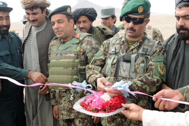 Brig. Gen. Ghulam Sarari Murtaza, commander of 3rd Brigade, 205th Afghan National Army Corps, (second from right) cuts the ribbon ceremonially opening the ground development at the Kandalay school and clinic site, Oct. 10.