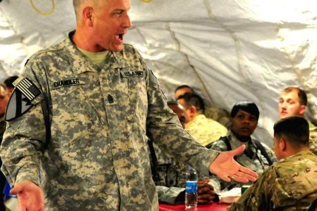 Sgt. Maj. of the Army Raymond F. Chandler III speaks to noncommissioned officers at Camp Stone, Afghanistan, during a dinner Oct. 18, 2011. Chandler was the camp near Herat, Afghanistan, as part of a battlefield circulation.