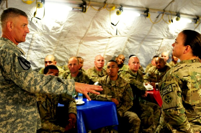 Sgt. Maj. of the Army Raymond F. Chandler III answers a Soldier's question during a dinner question and answer sessionat Camp Stone, Afghanistan, Oct. 18, 2011.