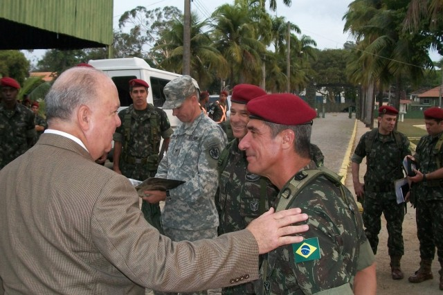 Under Secretary of the Army Joseph W. Westphal thanks Maj. Gen. Fernando Jose' Lavaquail Sardenberg, commander of the Brazilian Airborne Brigade, during a tours of the unit in Rio De Janiero, Brazil. Westphal met with the unit in order to assess future Army requirements and discuss regional security and cooperation efforts. Discussions centered on maintaining the Army-to-Army and service-to-service relationship that the U.S. and Brazil have developed over the years, and the Brazilian Army's role during the 2014 World Cup and 2016 Olympics. Westphal stressed the importance of maintaining relationships, expanding partnerships into areas of mutual interest and deepening U.S.-Brazil defense cooperation to effectively confront shared security challenges.